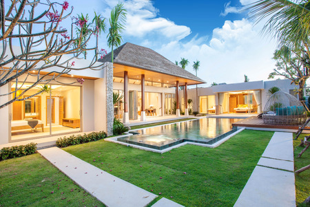 exterior and interior design of pool villa which features living area, greenery garden Stock Photo