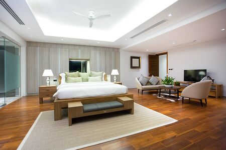 bedspread: Luxury Interior design in bedroom of pool villa with cozy king bed. Bedroom with high raised ceiling