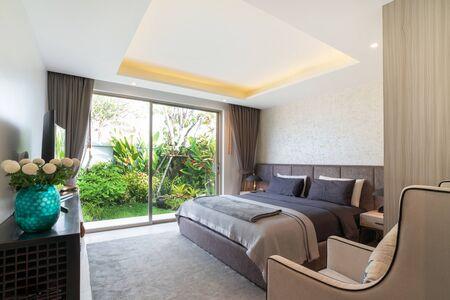 interior design in bedroom of pool villa with cozy king bed