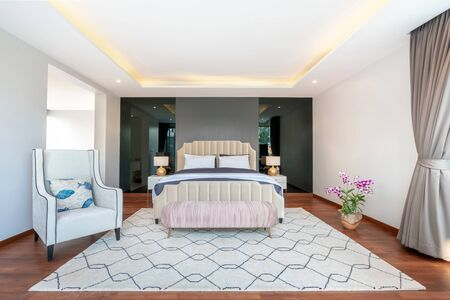 real estate Luxury Interior design in bedroom of pool villa with cozy king bed.