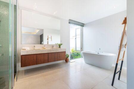 Luxury bathroom features basin and bathtub home, house ,building