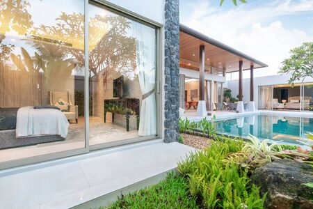 home or house Exterior design showing tropical pool villa with greenery garden and bedroom