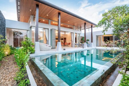 home or house building Exterior and interior design showing tropical pool villa with green garden and bedroom