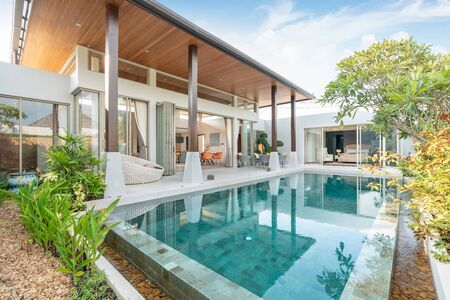home or house building Exterior and interior design showing tropical pool villa with green garden