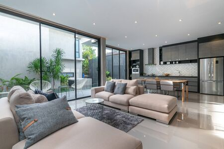 interior home design in living room with open kitchen in the loft house