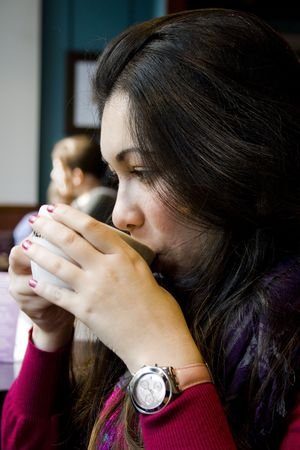 A beautiful model on a break with a cup of coffee Stock Photo - 7505316