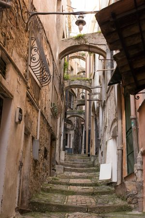 sanremo: Panoramic view of an alley between old houses in Sanremo, Liguria, Italy Stock Photo