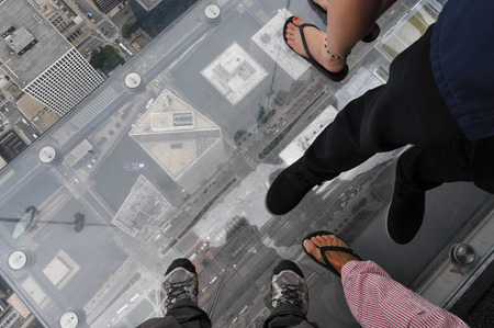 Feet on the glass balcony of the Willis Tower, Chicago