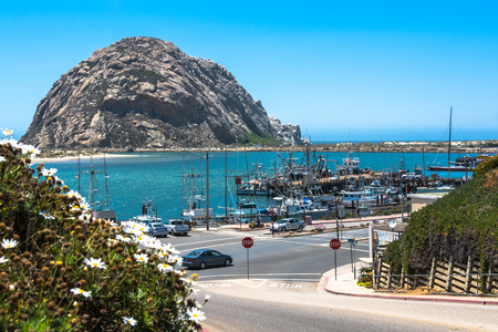 breakwaters: Morro Rock in front of Morro Bay, California Stock Photo