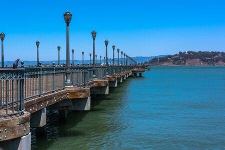 extending: Pier extending towards the ocean, San Francisco Stock Photo