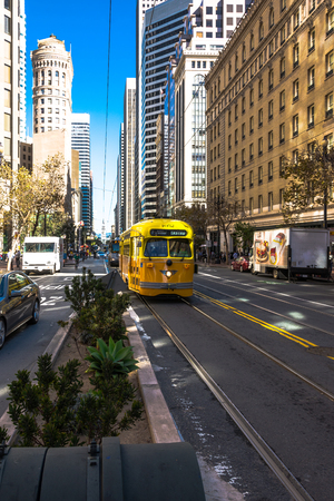 trams: The yellow trams on Market Street in San Francisco Editorial