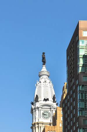atop: The statue atop City Hall Tower in Philadelphia, Pennsylvania