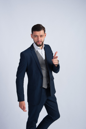 human arm: A man in a business suit.