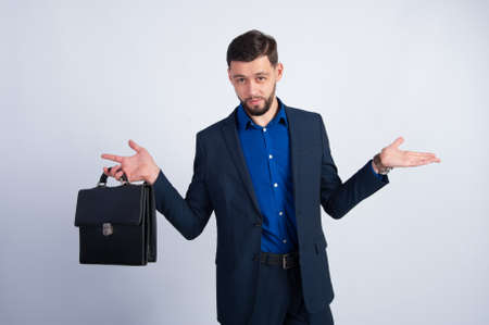leather briefcase: Young businessman with a leather briefcase