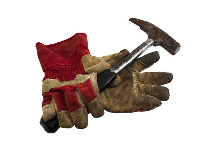 old work gloves and a hammer on a white background Stock Photo - 14571922