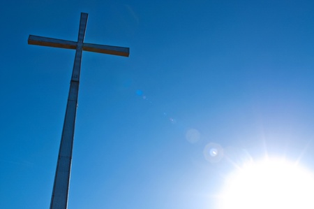 cross with sky and sun in the background Stock Photo - 15252581