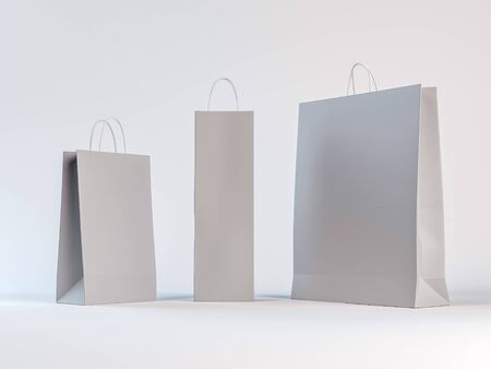 bag: Three different sizes of paper bags on a white background. Empty space with shadows allows easy placement of your design. Stock Photo
