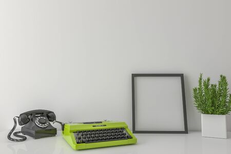 photo wall: Desktop with blank picture frame old phone and typewriter - mock up