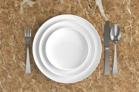 grunge flatware: three empty plates, spoon, fork and knife on a wooden base Stock Photo