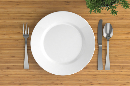 grunge flatware: empty plate, spoon, fork and knife on a wooden base Stock Photo