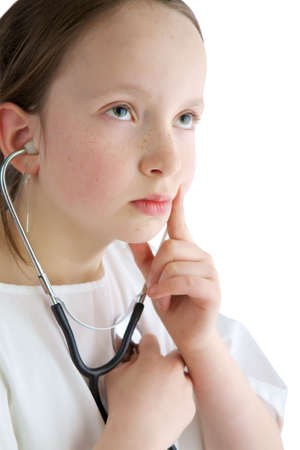 Little girl with a white coat and stethoscope photo