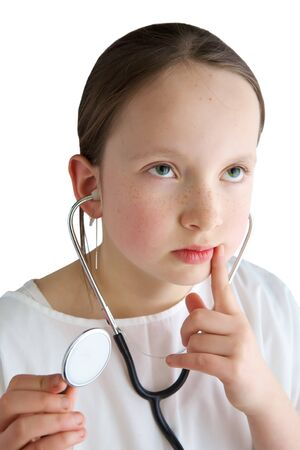 Little girl with a white coat and stethoscope Stock Photo - 7411404