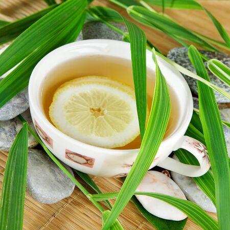 Healthy green tea cup wiht lemon photo