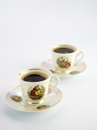 Beautiful old coffee cups with a drawing photo
