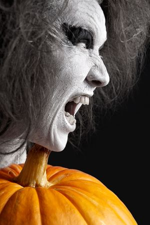 bleached: Woman with a bleached face and pumpkin. Halloween theme.