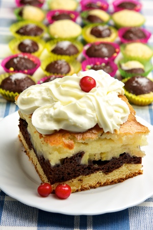 Homemade pie with whipped cream and muffins photo
