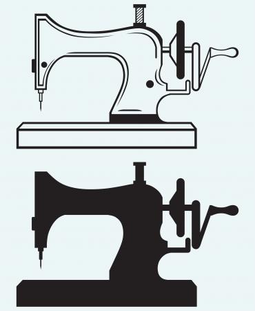 maquina de coser: Máquina de coser antigua aisladas sobre fondo azul Vectores