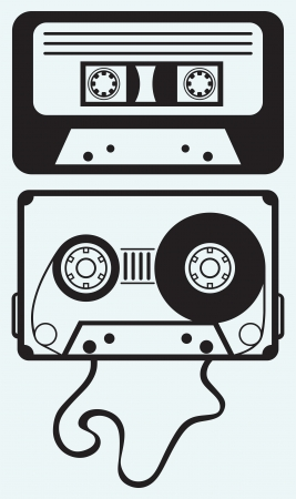 Audio cassette tape isolated on blue background