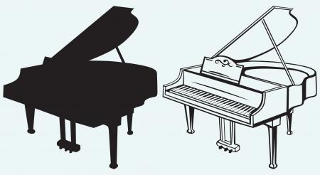 青色の背景に分離されたグランド ピアノ