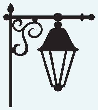 wrought: Silhouette lamp of wrought metal isolated on blue background