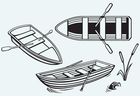 Houten boot met peddels geïsoleerd op blauwe achtergrond