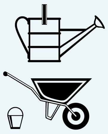 barrow: Garden wheelbarrow and watering can isolated on blue background