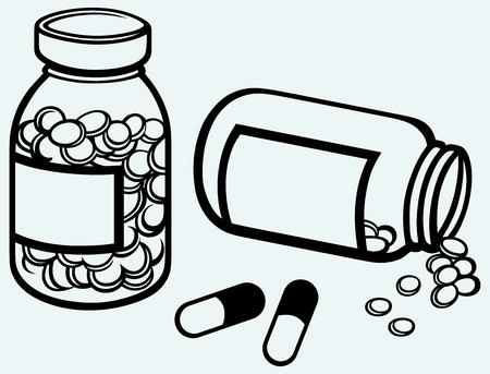 recetas medicas: Botella de píldora píldoras que se derraman a superficie aislada sobre fondo azul