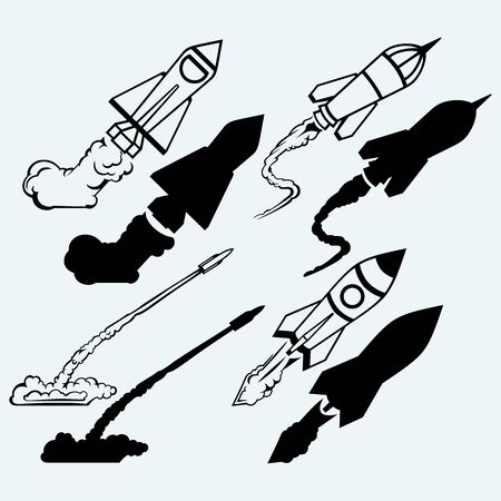 mosca caricatura: Rocket icon. Isolated on blue background. Vector silhouettes