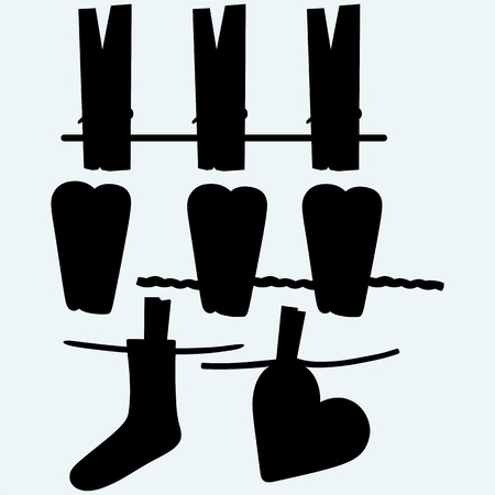 clap: Clothespins on rope. Heart in clothesline. Socks made of a clap in clothesline. Isolated on blue background. Vector silhouettes Illustration