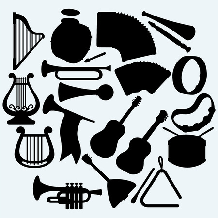 lyre: Different music instruments. Isolated on blue background. Vector silhouettes
