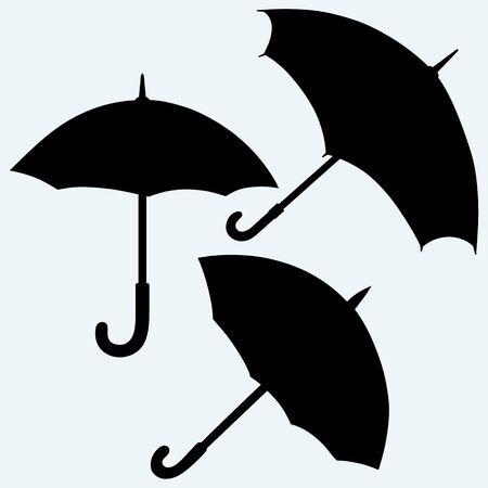 convolute: Set black umbrella. Isolated on blue background. Vector silhouettes Illustration