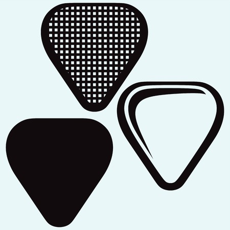 fluted: Guitar plectrum. Image isolated on blue background