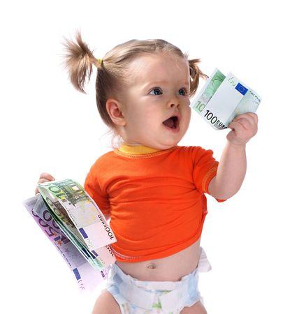 Baby taking euro. photo