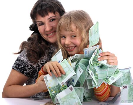 A happy mother with a child holds a money.   Stock Photo - 2513735
