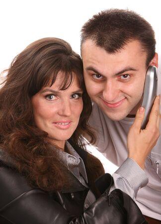 Woman with telephone near man. photo