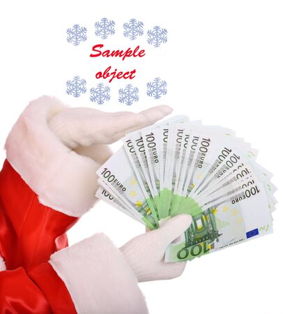 Money in hand of santa claus. photo