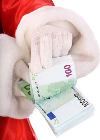 Money in hand of santa claus. photo