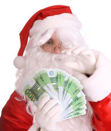 Santa Claus holding money. Isolated. photo