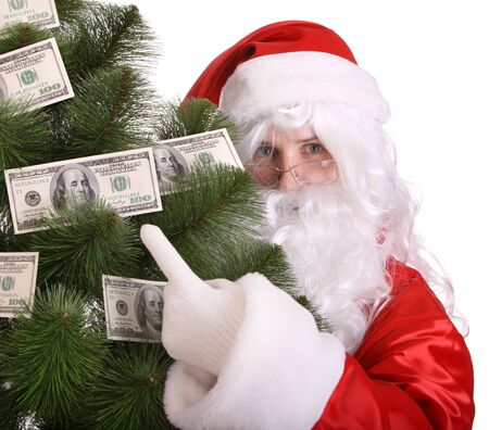 Santa Claus holding money. Isolated. photo