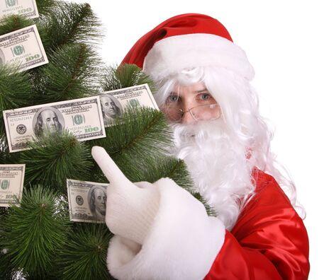 Santa Claus holding money. Isolated. Stock Photo - 3929554